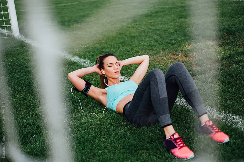 Fit Woman Doing Abs Workout by Katarina Radovic for Stocksy United