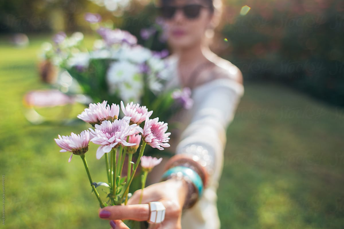 Spring time cute woman holding bouquet of flowers stocksy united spring time cute woman holding bouquet of flowers by jovo jovanovic for stocksy united izmirmasajfo