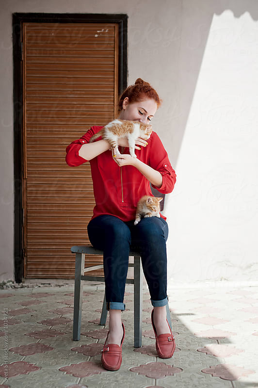 The red-haired girl and her kittens by Sveta SH for Stocksy United