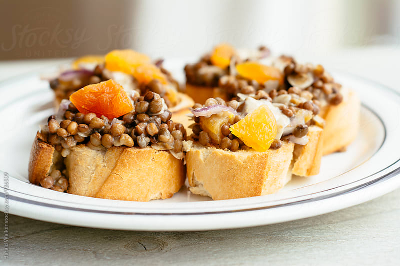 Lentil, Apricot Bruschetta with Curry Aioli by Harald Walker for Stocksy United