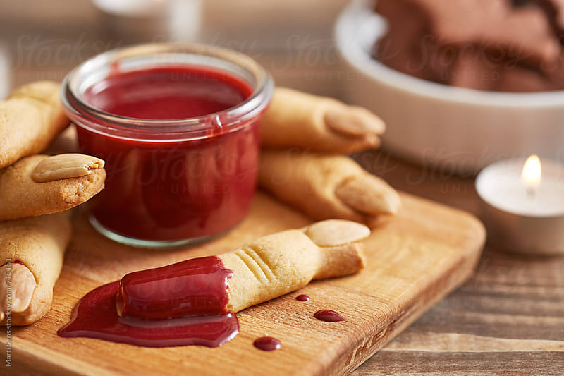 Butter cookie fingers with red chocolate ganache by Martí Sans for Stocksy United