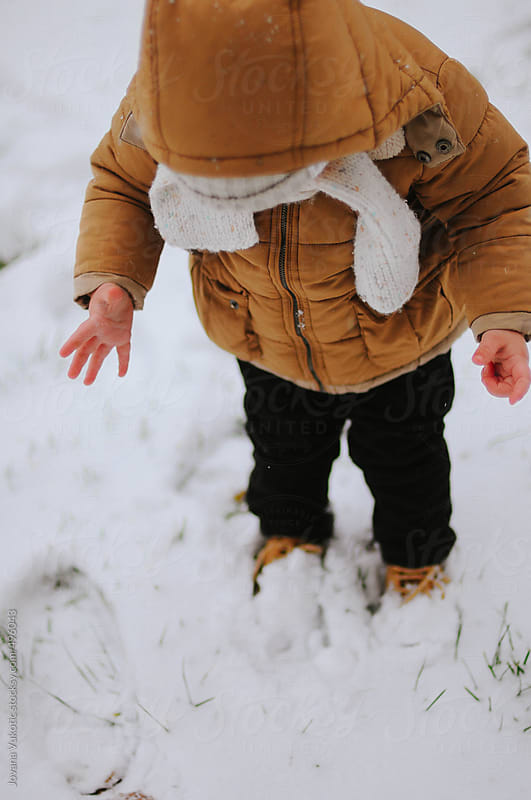 Child playing on the snow by Jovana Vukotic for Stocksy United