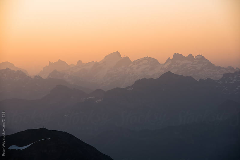 Silhouette of Titlis mountain peak at sunrise, Brienzer Rothorn, by Peter Wey for Stocksy United