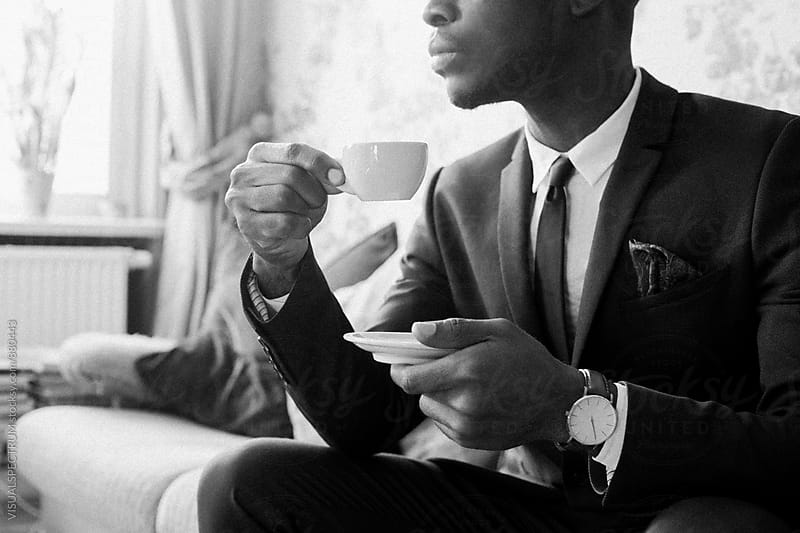 Black and White Portrait of Young Black Man Drinking Espresso by VISUALSPECTRUM for Stocksy United