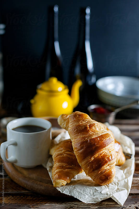 Breakfast: Croissants and coffee. by Darren Muir for Stocksy United