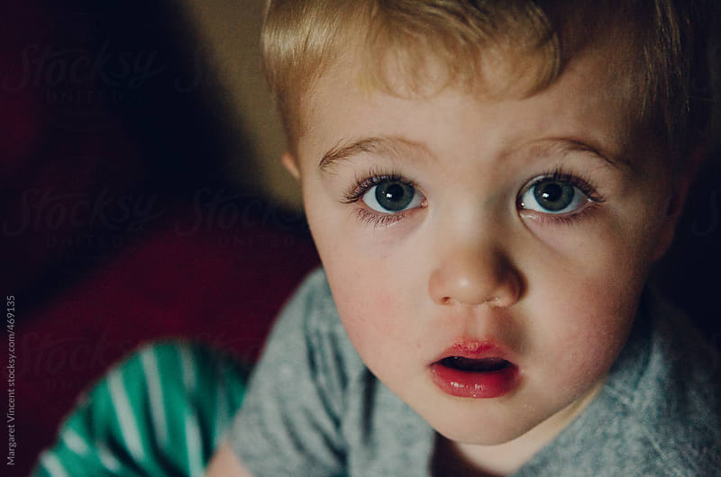 close-up of a two-year-old boy by Margaret Vincent for Stocksy United