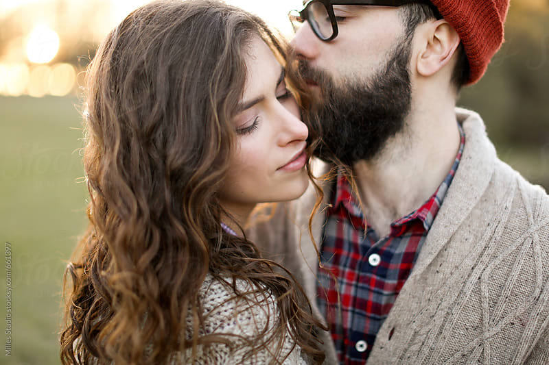 Kissing couple outdoor by Milles Studio for Stocksy United