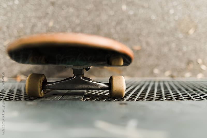 Skateboard leaning against wall by Isaiah & Taylor Photography for Stocksy United