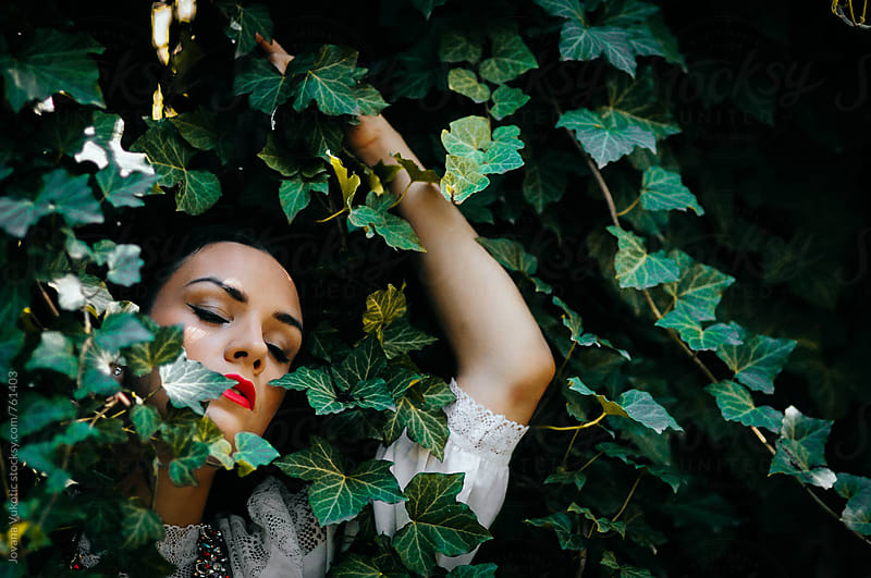 Woman surrounded by leaves by Jovana Vukotic for Stocksy United