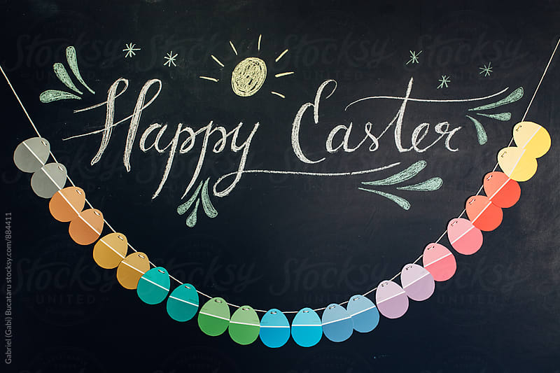 Happy Easter message on a blackboard with paper egg banner by Gabriel (Gabi) Bucataru for Stocksy United