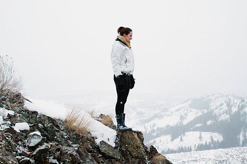 Young woman stands on Mountain in winter by Jesse Morrow for Stocksy United