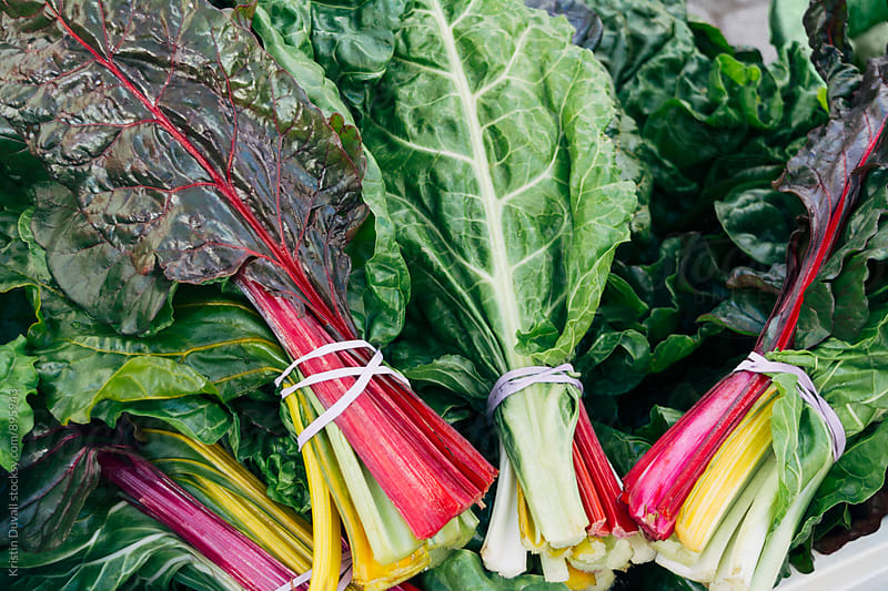 Bunches of rainbow chard by Kristin Duvall for Stocksy United