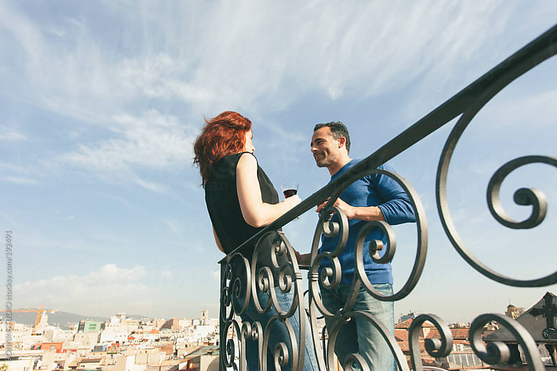 Beautiful couple drinking wine on the rooftop. by BONNINSTUDIO for Stocksy United