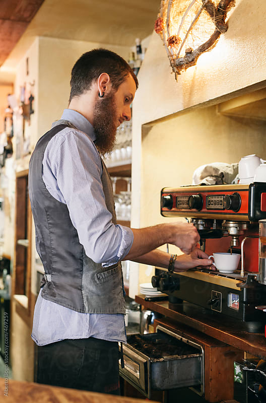 Barista making coffee by Alberto Bogo for Stocksy United