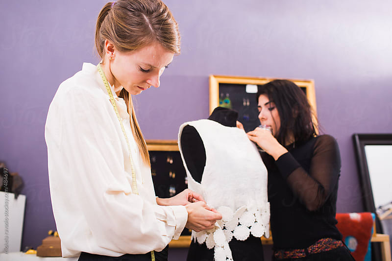 Two young fashion designers placing their creation by michela ravasio for Stocksy United