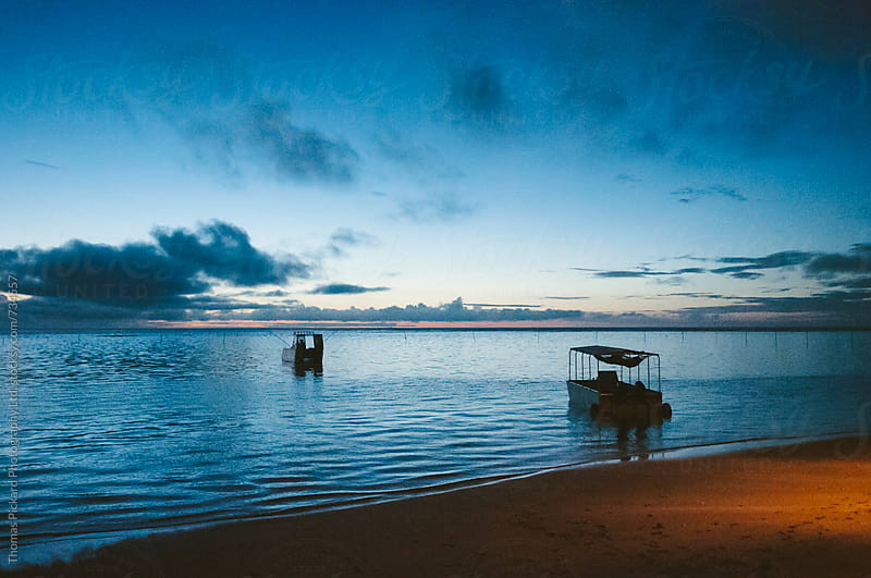 Beach, boats, sunset, Samoa. by Thomas Pickard for Stocksy United