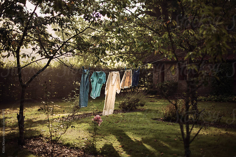 Clothes drying in the morning sun by Kitty Kleyn for Stocksy United