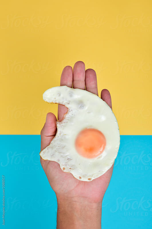 fried egg by Juan Moyano for Stocksy United