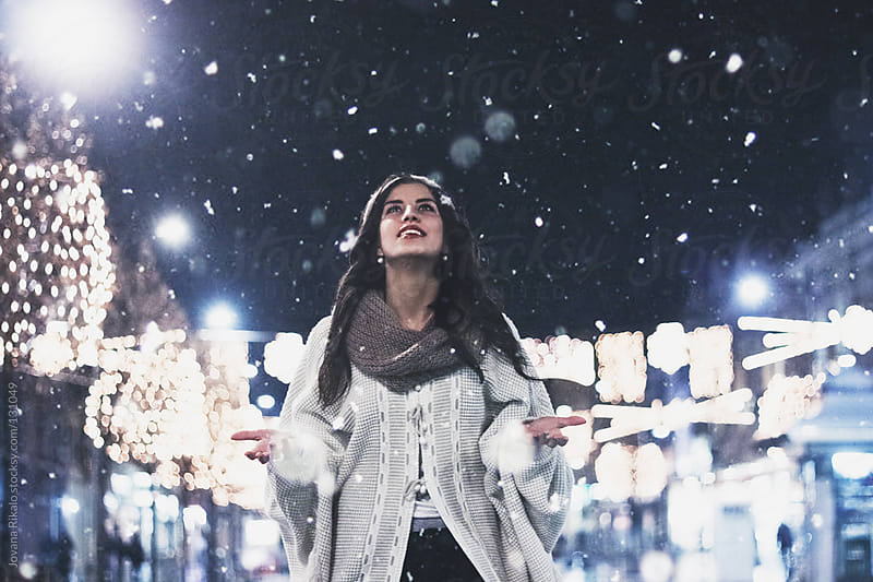 Girl is happy because is snowing by Jovana Rikalo for Stocksy United