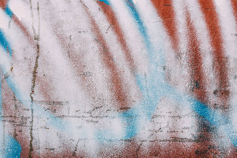 Brightly colored graffiti spray paint on metal container, close up by Paul Edmondson for Stocksy United