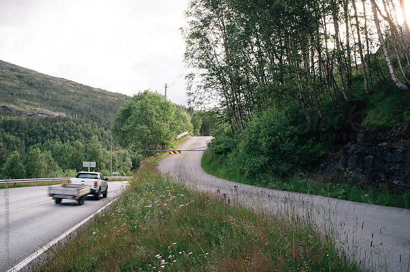 Car is passing on the road by Tomas Mikula for Stocksy United
