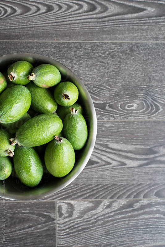 Feijoa fruit in stainless steel bowl, New Zealand. by Thomas Pickard Photography Ltd. for Stocksy United