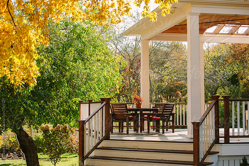 New England Porch in Autumn by Raymond Forbes LLC for Stocksy United