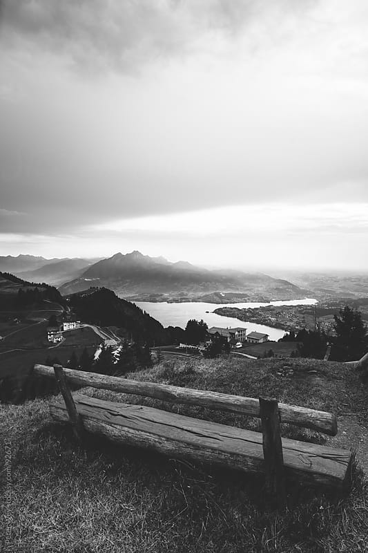 empty park bench at Rigi by Peter Wey for Stocksy United