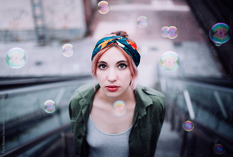 portrait of a woman with bubbles by Thais Ramos Varela for Stocksy United