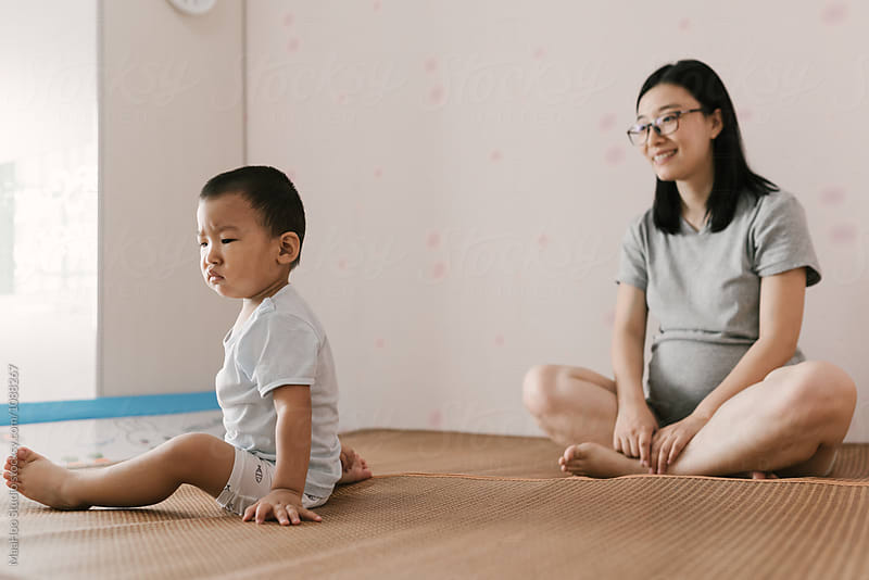 Toddler boy and his mother playing on bed by MaaHoo Studio for Stocksy United