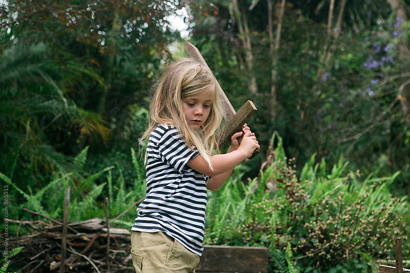 Child playing with wooden sword by Tahl Rinsky for Stocksy United