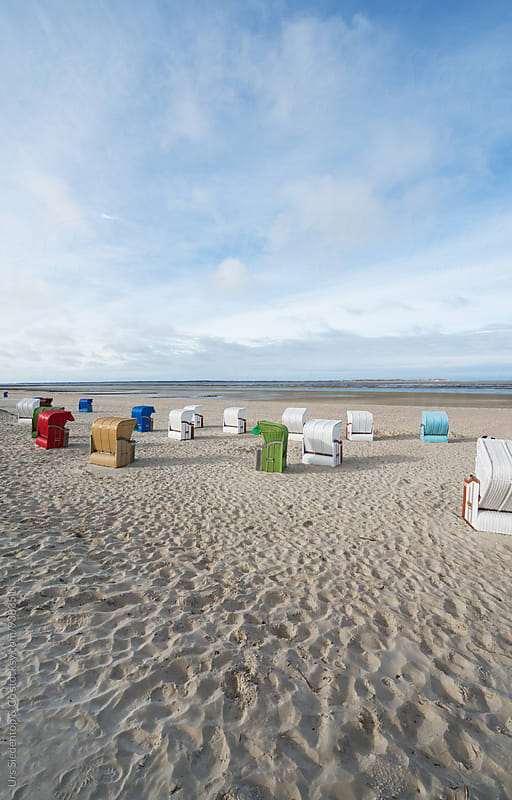 Colourful Beach Chair Arrangement  by Urs Siedentop & Co for Stocksy United