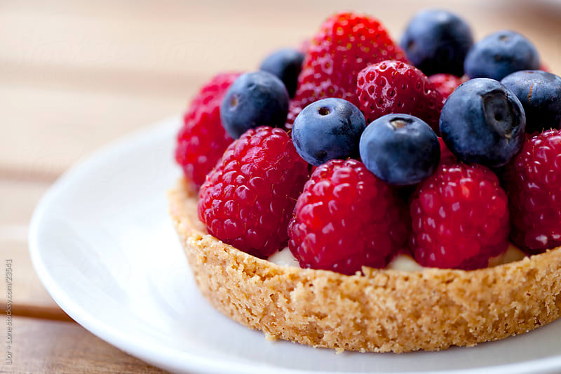 Blueberry and raspberry tart by Lior + Lone for Stocksy United