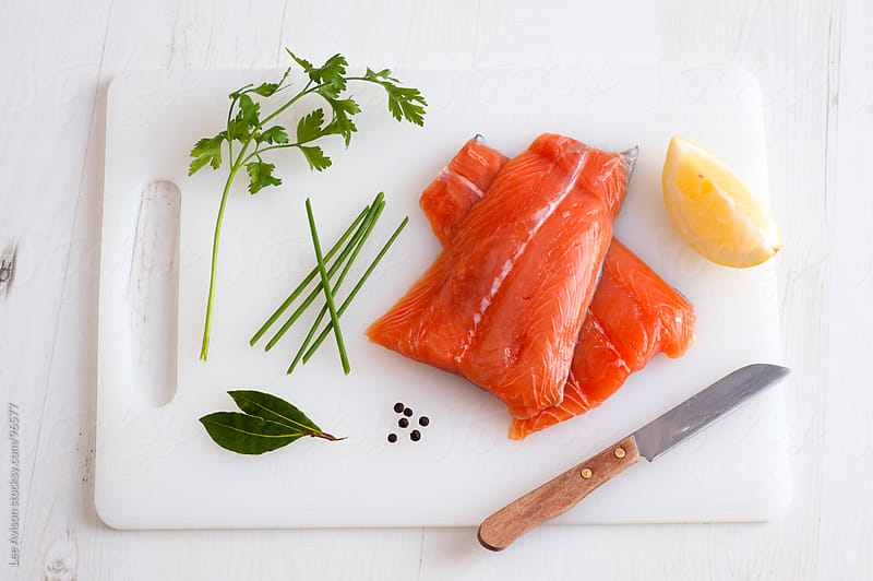 fresh raw salmon fillets by Lee Avison for Stocksy United