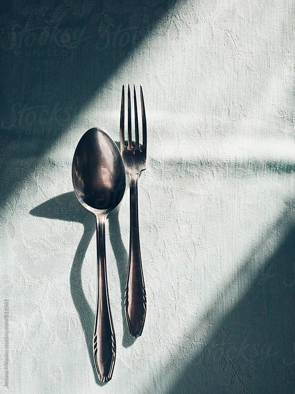 Fork and a spoon on the table in beautiful light by Jovana Milanko for Stocksy United
