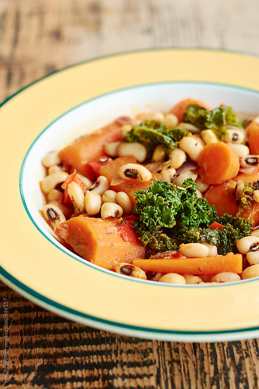 Black-eyed peas and kale soup by Harald Walker for Stocksy United