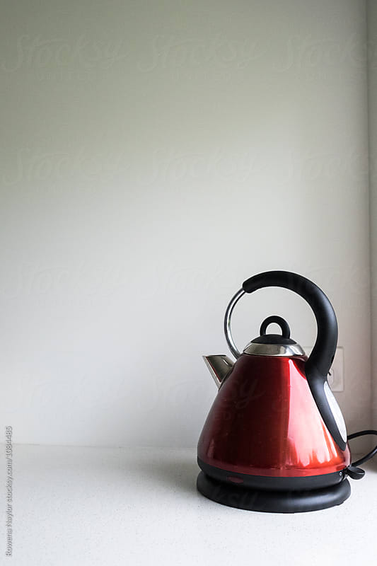 Red electric kettle by Rowena Naylor for Stocksy United