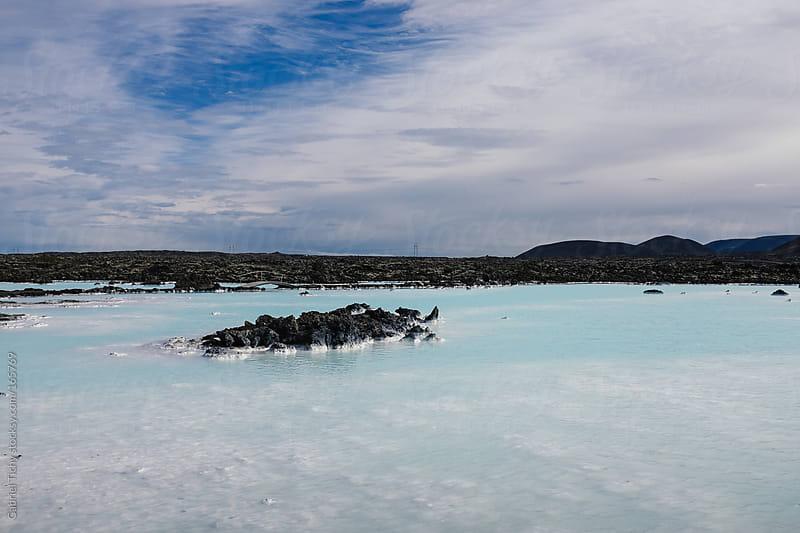 Rocks in Blue Lagoon by Gabriel Tichy for Stocksy United
