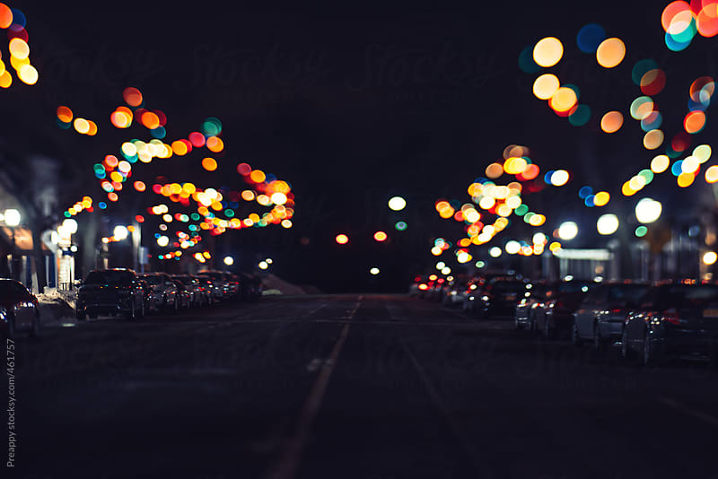 Illuminated lights on empty street at night by Preappy for Stocksy United