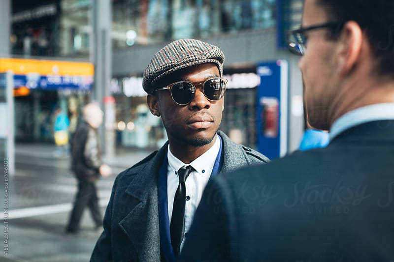 Stylish Young Black Businessman Meeting With Caucasian Businessman on Sunny Spring Day by Julien L. Balmer for Stocksy United