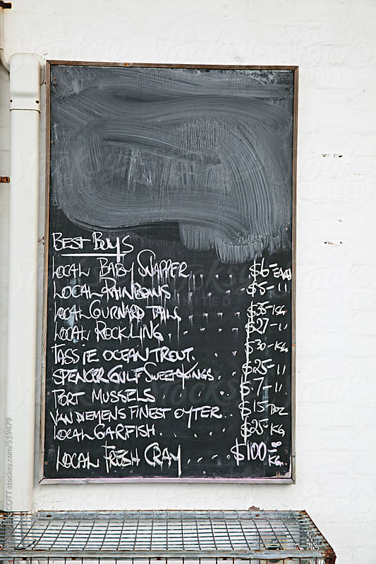 blackboard / chalkboard with fresh fish for sale by Natalie JEFFCOTT for Stocksy United