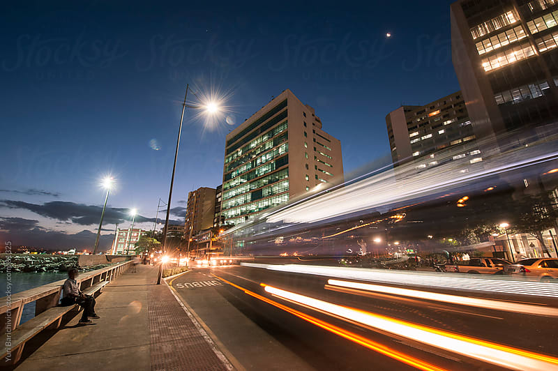 Night car trails in downtown city. by Yuri Barichivich for Stocksy United