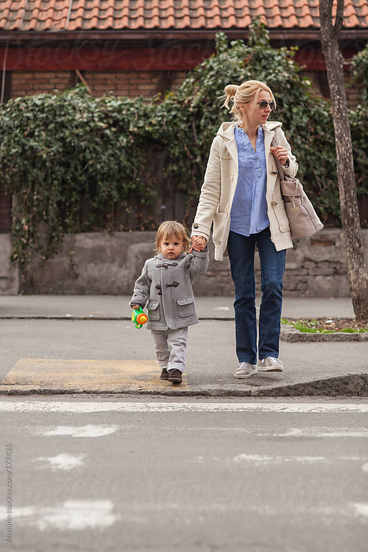 Mother and Son Crossing the Street by Mosuno for Stocksy United