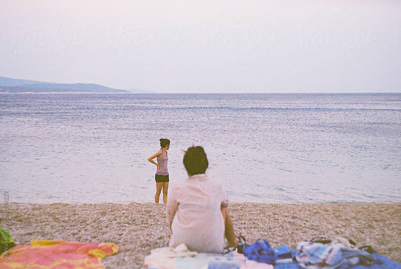 Two female friends on the beach during the morning  by VeaVea for Stocksy United