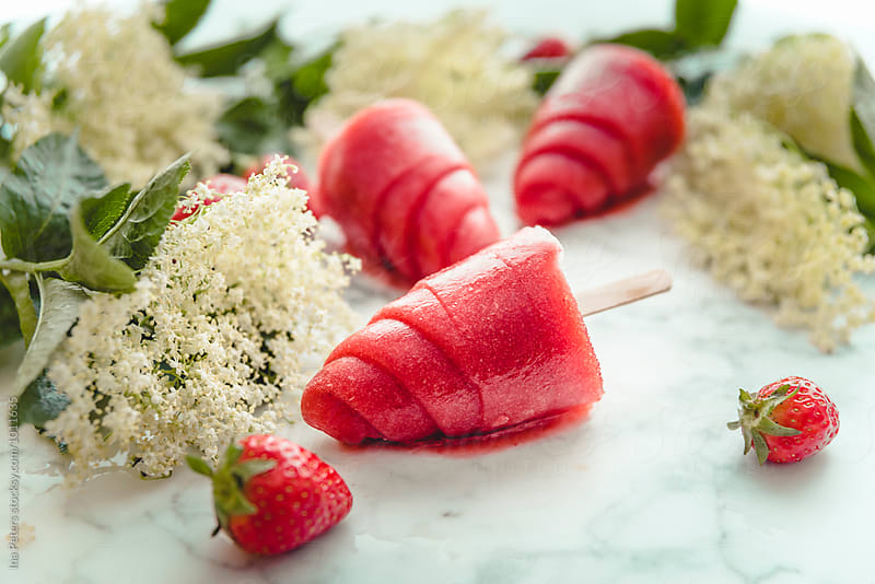 Food: Strawberry and Elderflower Popsicles by Ina Peters for Stocksy United