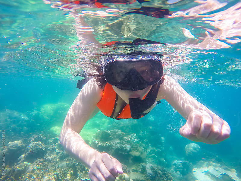 Asian girl snorkeling,Samui,Thailand by Miss Rein for Stocksy United