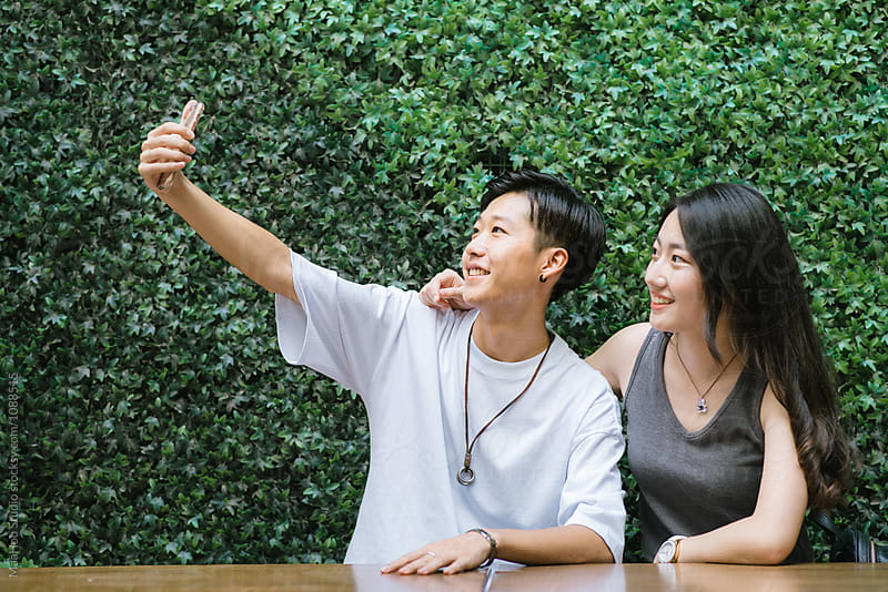Young Chinese teenagers taking selfie by Maa Hoo for Stocksy United