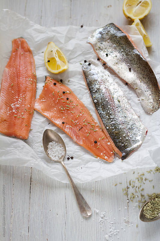 Salmon trout fillets with lemon by Noemi Hauser for Stocksy United