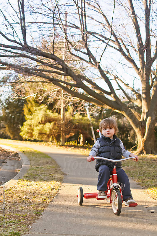 Toddler Riding Tricycle by Cameron Whitman for Stocksy United
