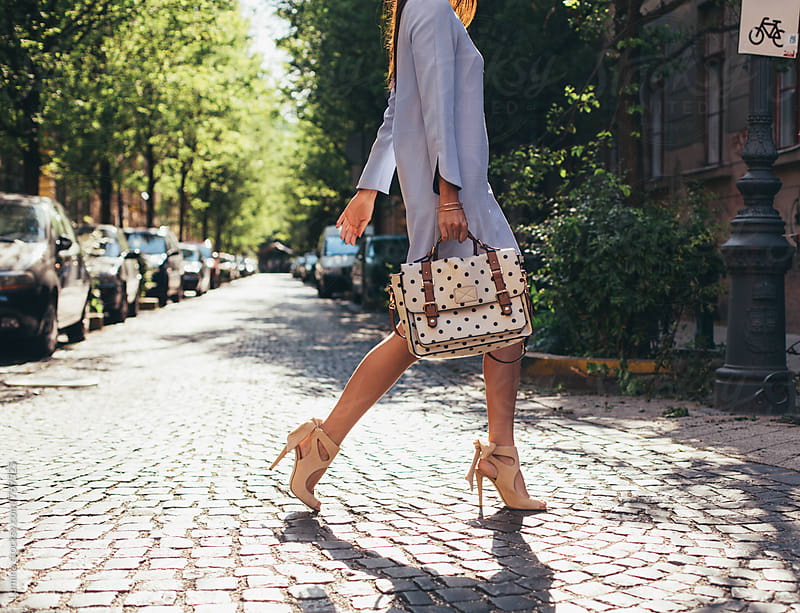 Elegant Woman Walking on the Street by Lumina for Stocksy United